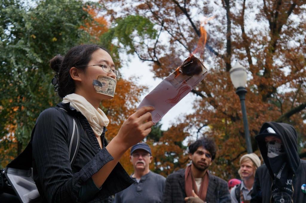 Portlander burns her ballot during the November 3rd Resist Austerity event.
